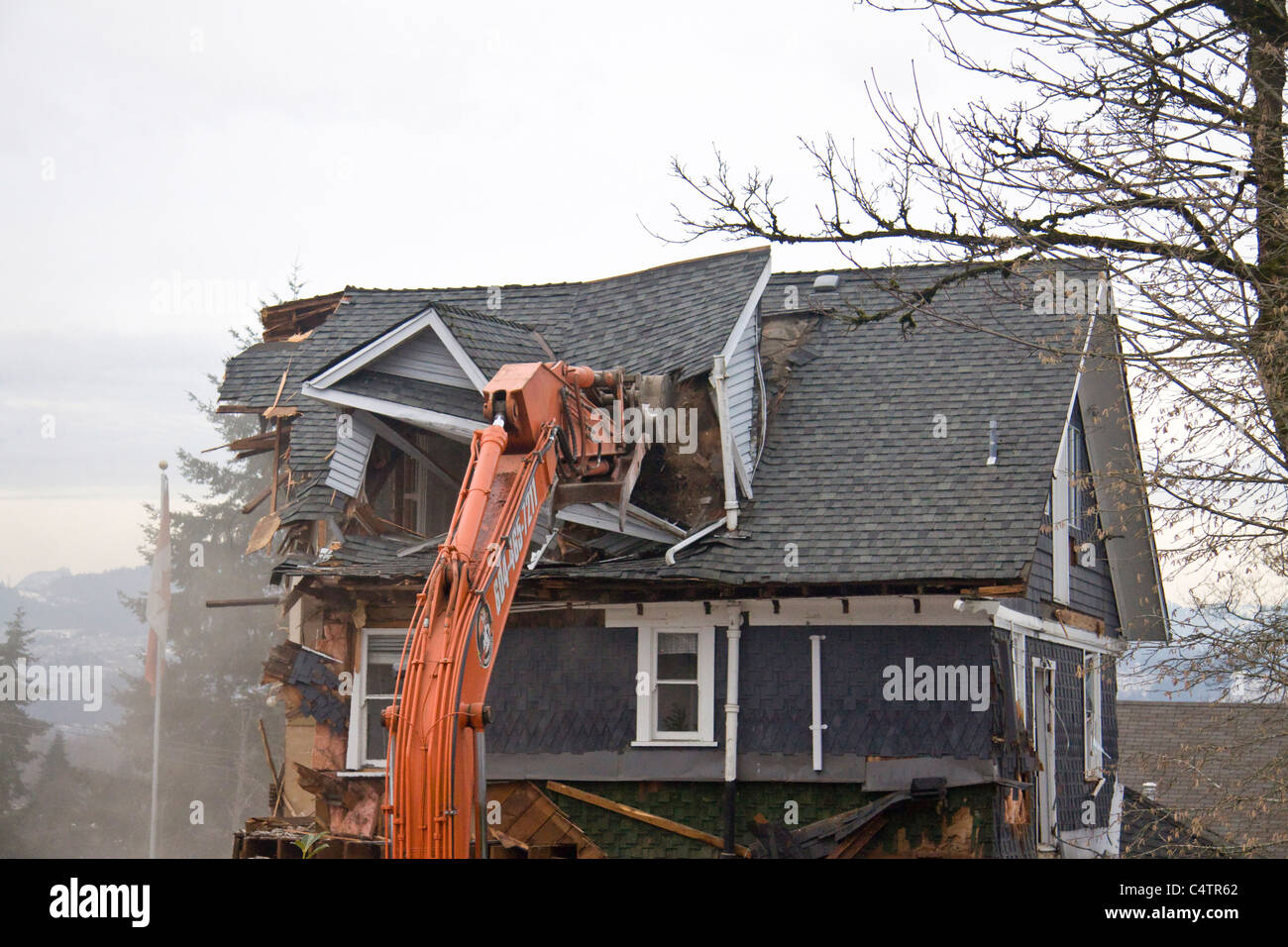 Beautiful character home being demolished to make way for a newer building - Stock Image