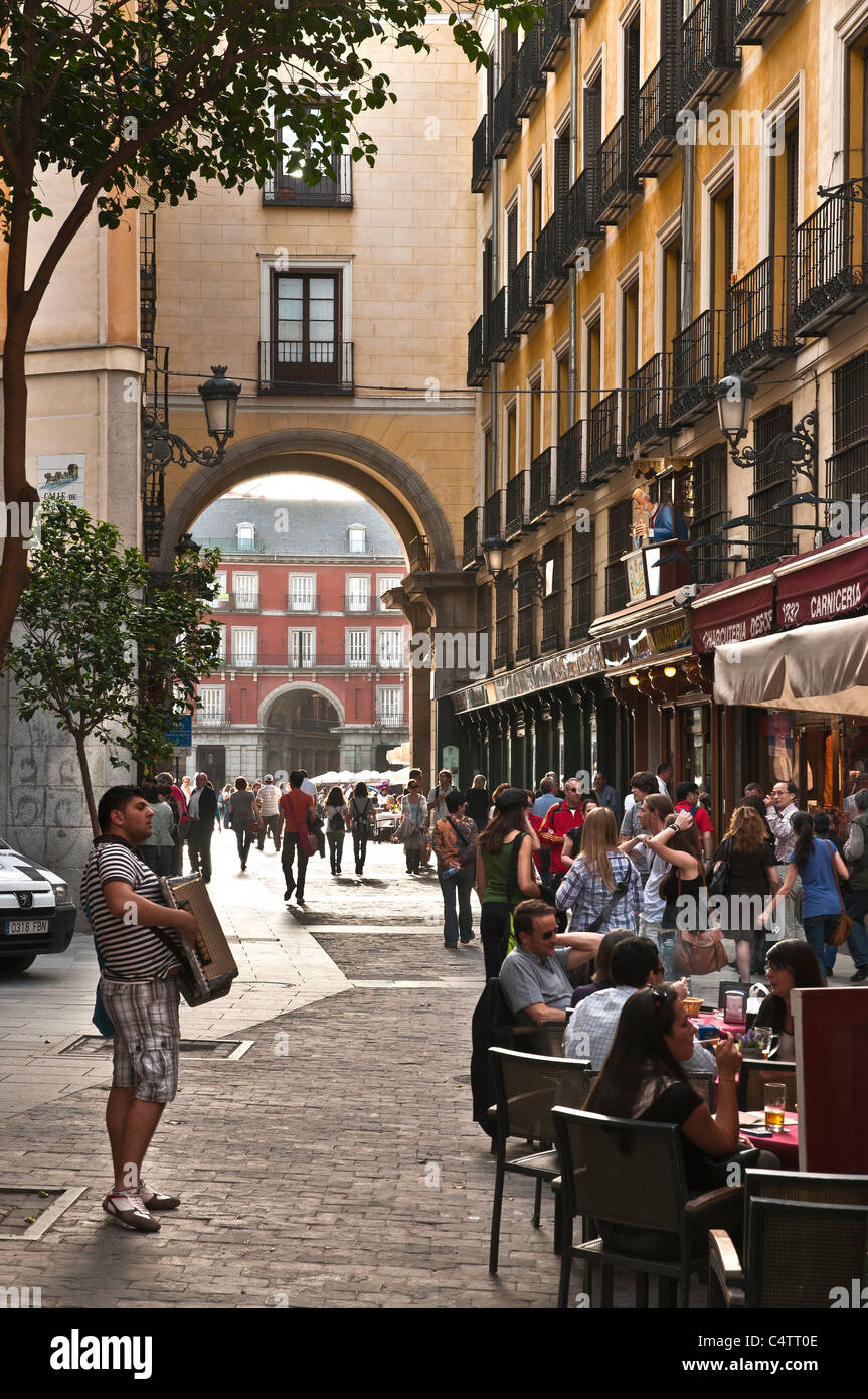 Late afternoon in the Calle de Zaragoza, with the Plaza Mayor in the background, Madrid, Spain - Stock Image