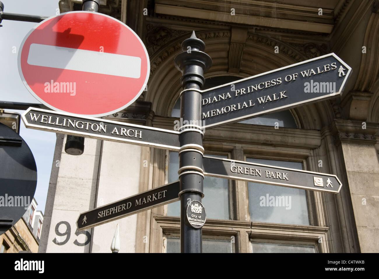 London Mayfair Piccadilly pedestrian tourist signpost to Wellington Arch Shepherd Market Green Park Princess Diana - Stock Image