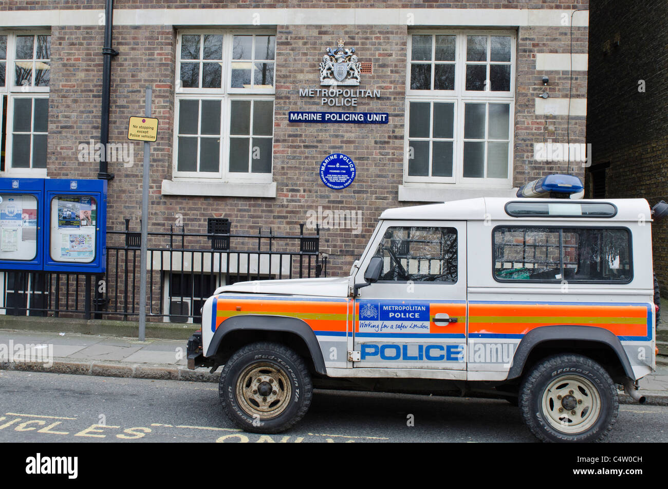 Marine Policing unit with Poiice Landrover Wapping High street London Uk - Stock Image