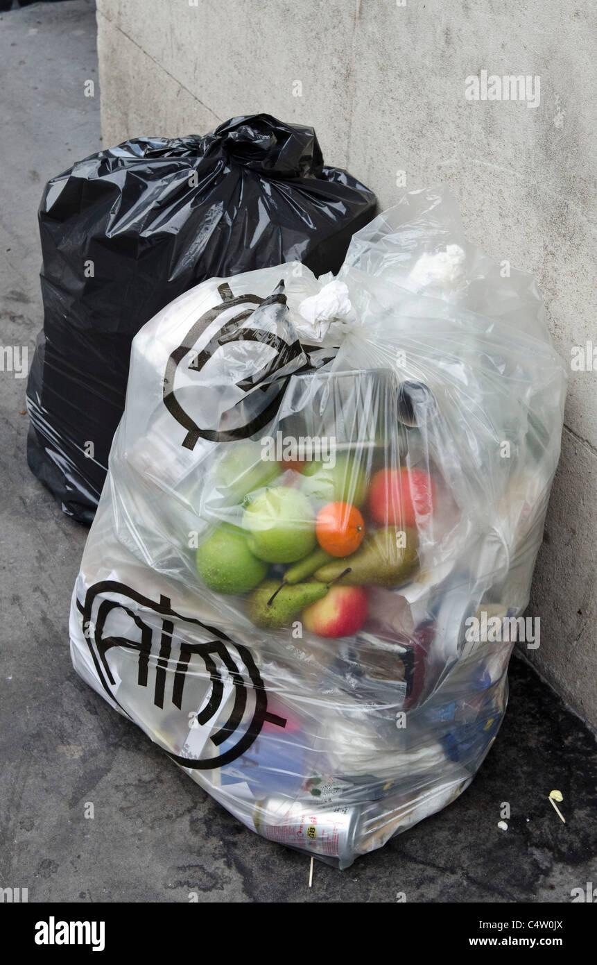 Good fruit thrown away. Wasted food. Poor recycling. Rubbish. Bin bags. London Uk - Stock Image