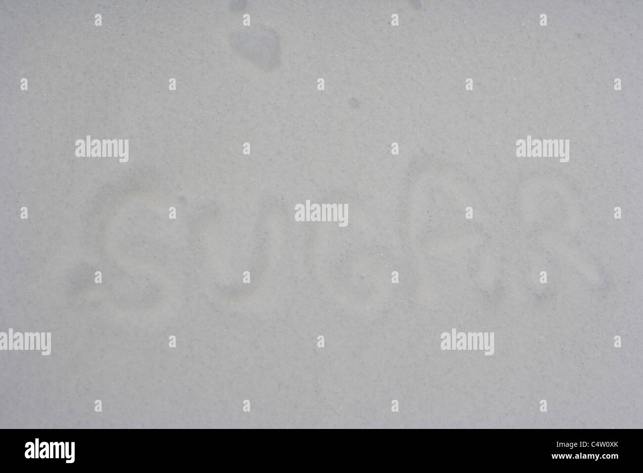 Word sugar written on castor sugar - Stock Image