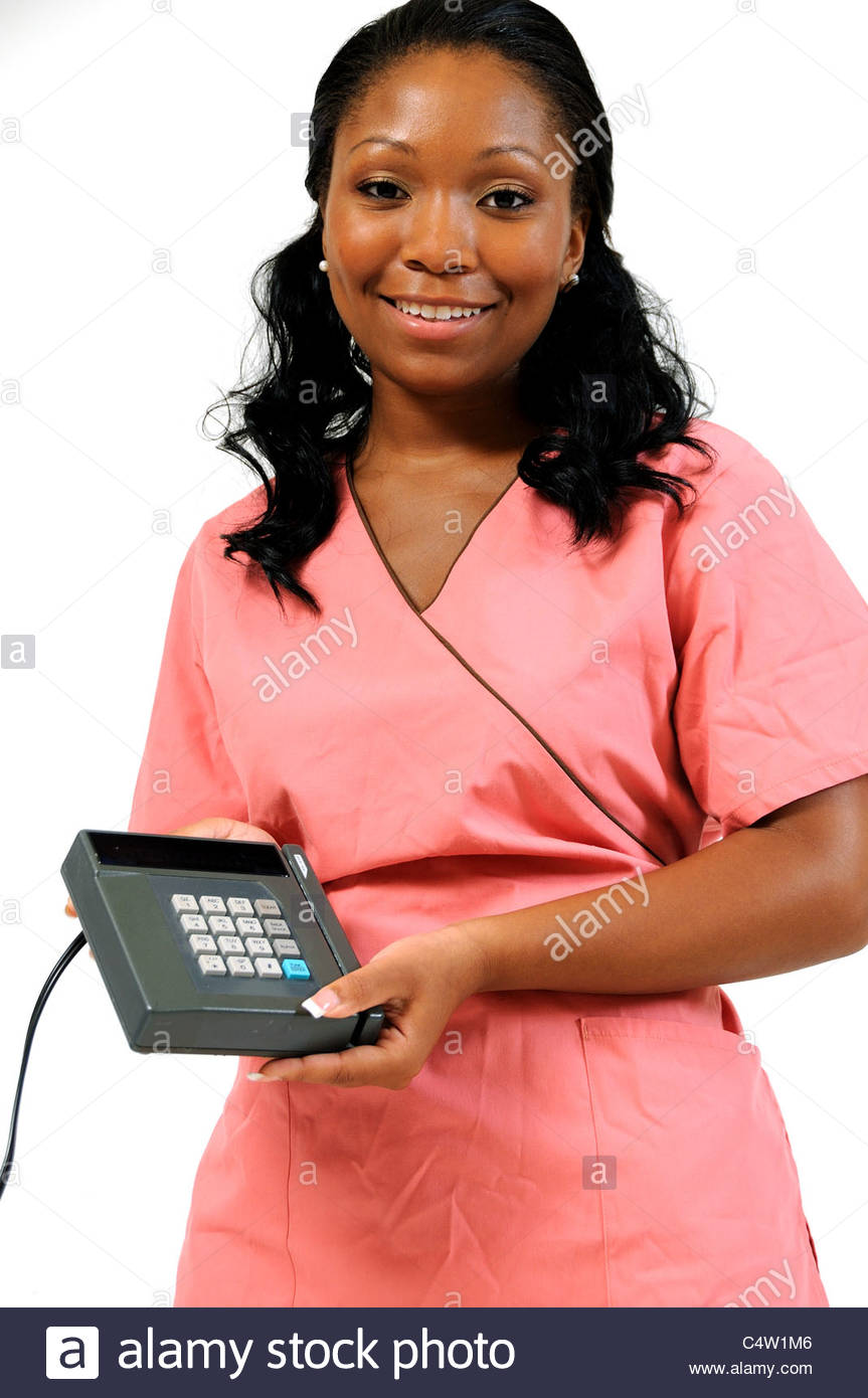 Attractive black medical professional holding charge card machine - health care costs - Stock Image
