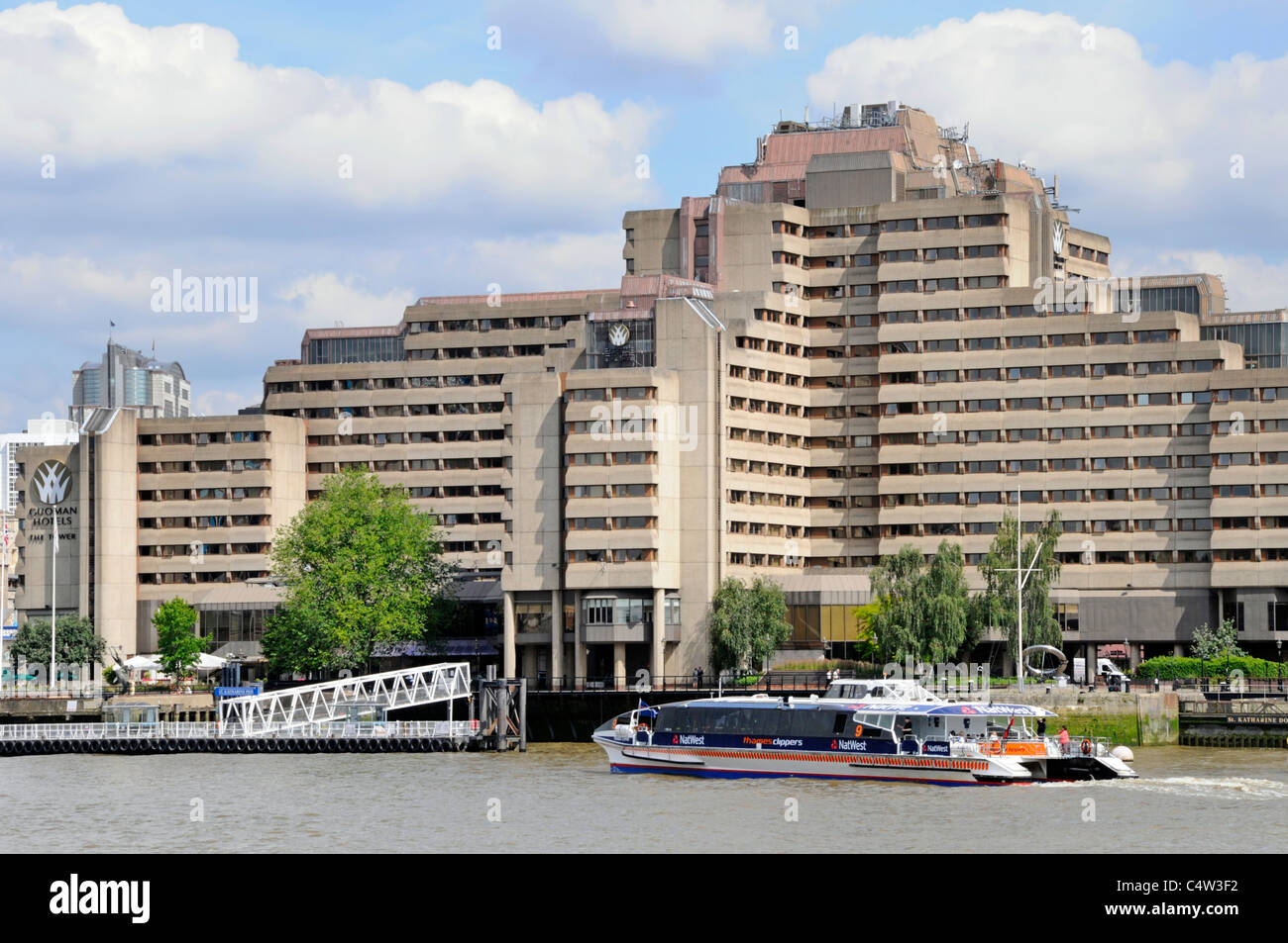 Thames clipper commuter tourism public transport passenger boat at St Katharines Pier & Guoman Hotel on River - Stock Image