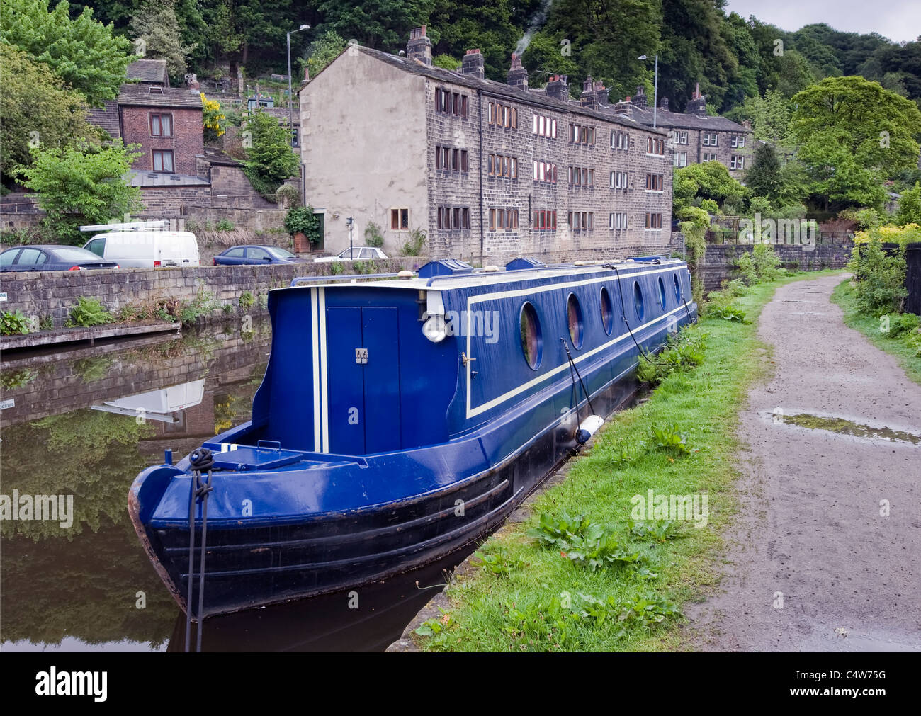 Blue narrowboat at moorings at the pennine town of Hebden bridge - Stock Image