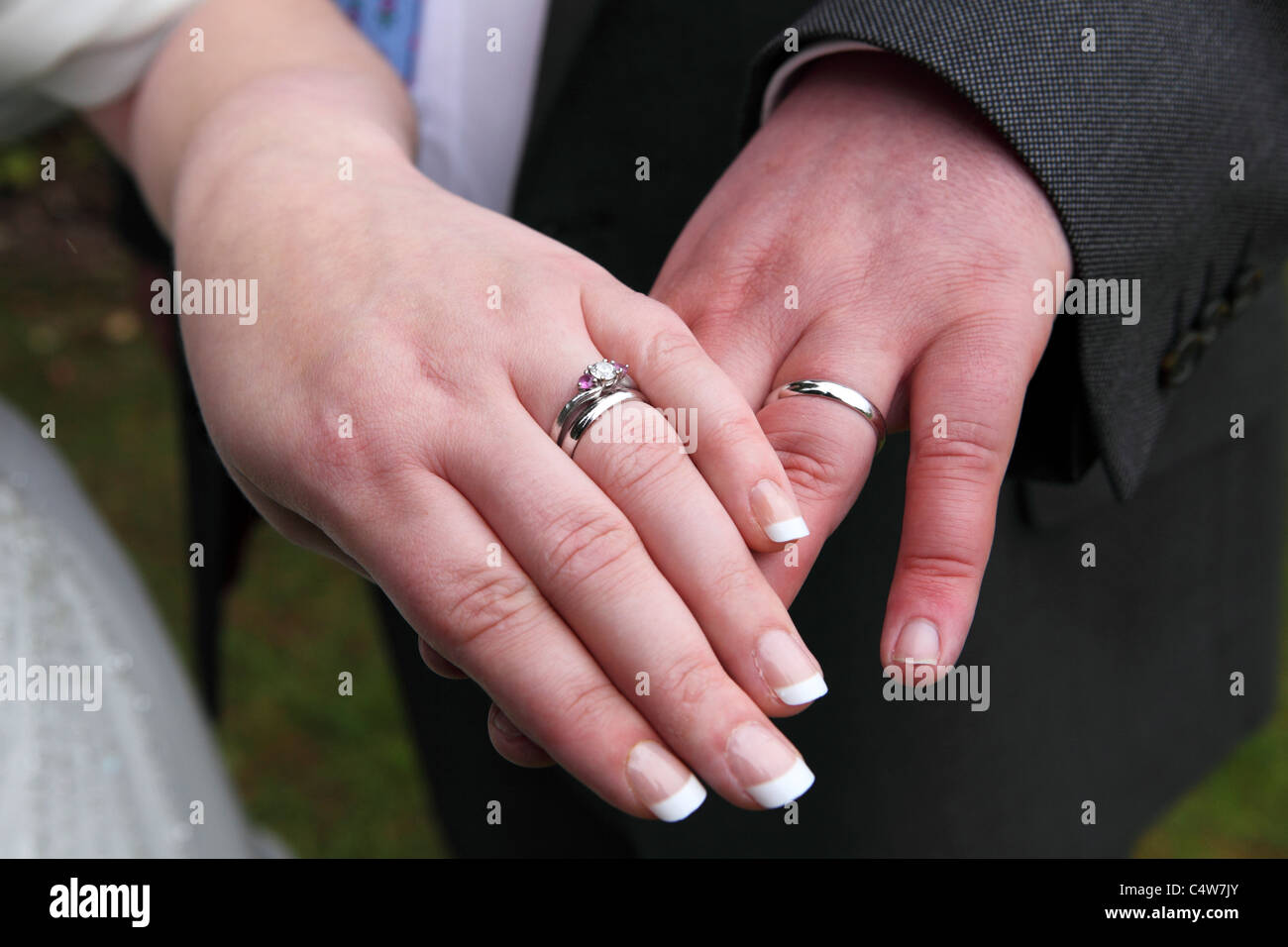 A man and woman show off their wedding rings after marrying Stock ...