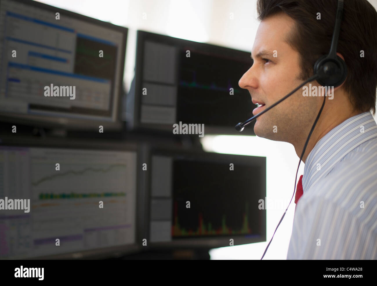 USA,New Jersey,Jersey City,financial worker analyzing data displayed on computer screen - Stock Image