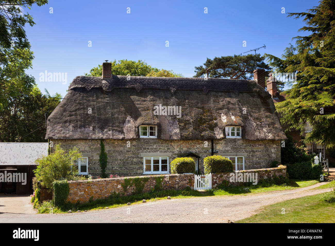 Beautiful tradition old country house on a sunny summer's day in the quaint village of Ashmore, Dorset, England, - Stock Image