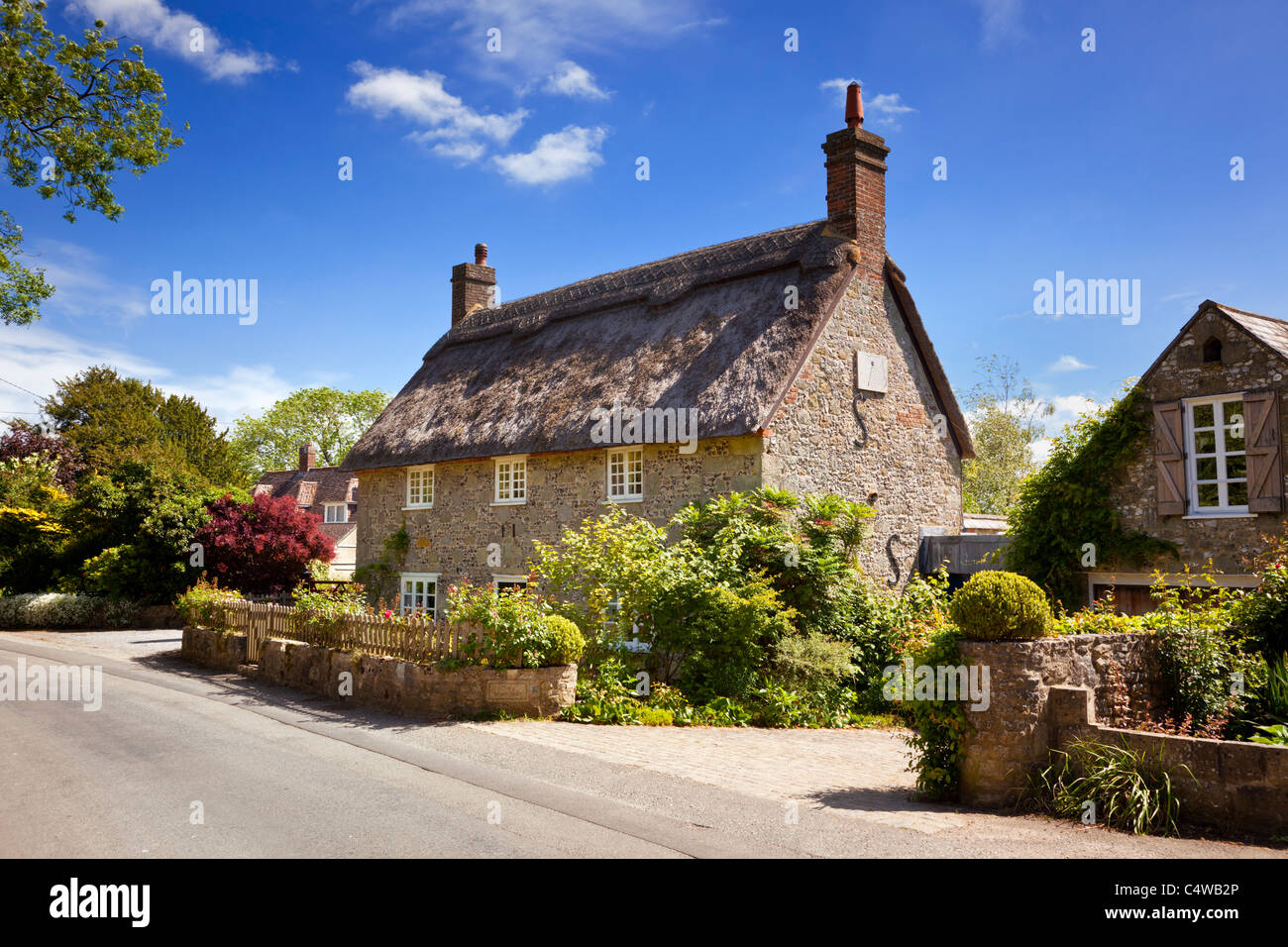 Thatched Cottage country house in the pretty English village of Ashmore, Dorset, England, UK - Stock Image