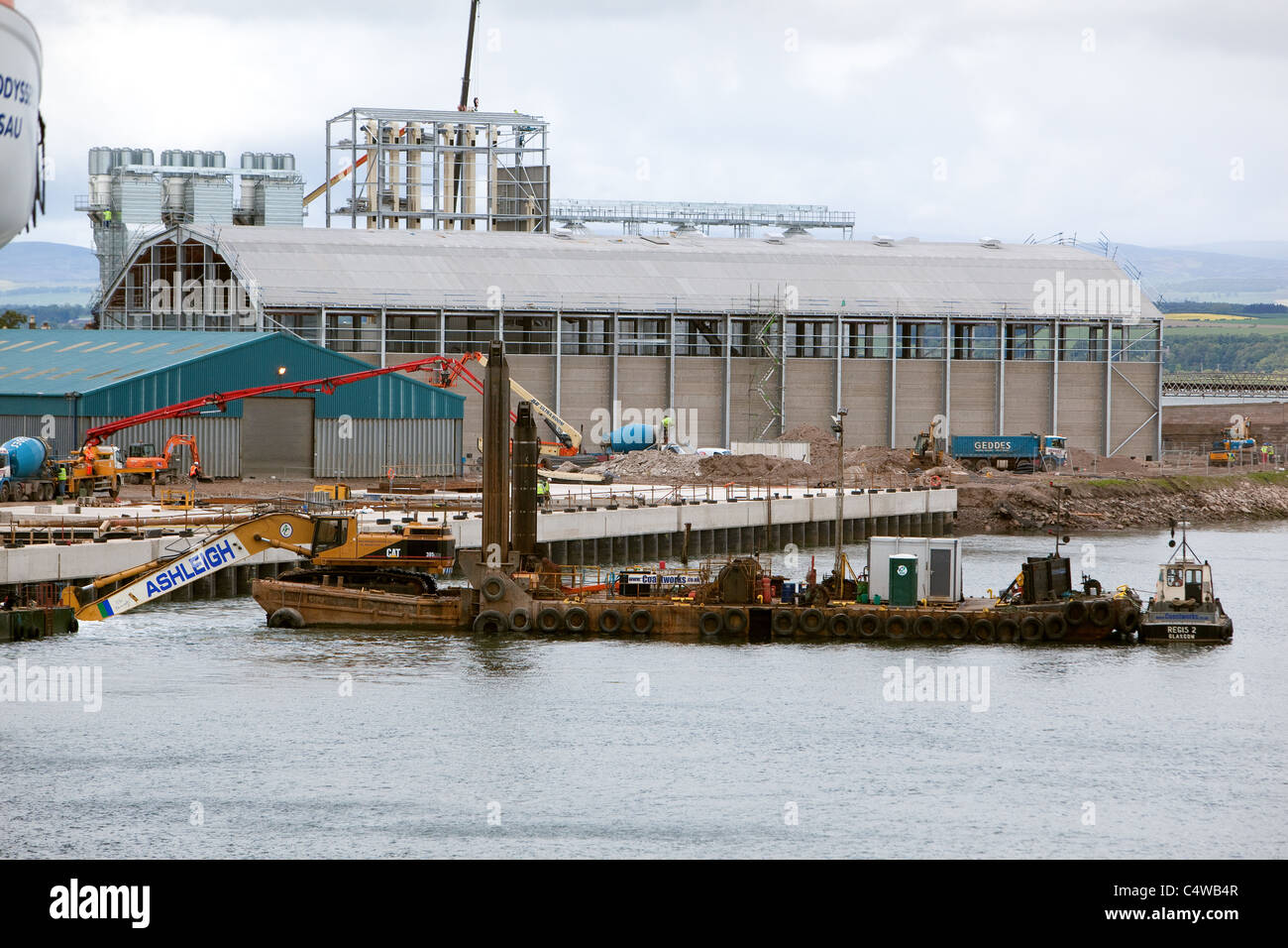 Dredging operations around construction of grain silos and new quaysides .Montrose Angus Scotland UK Stock Photo