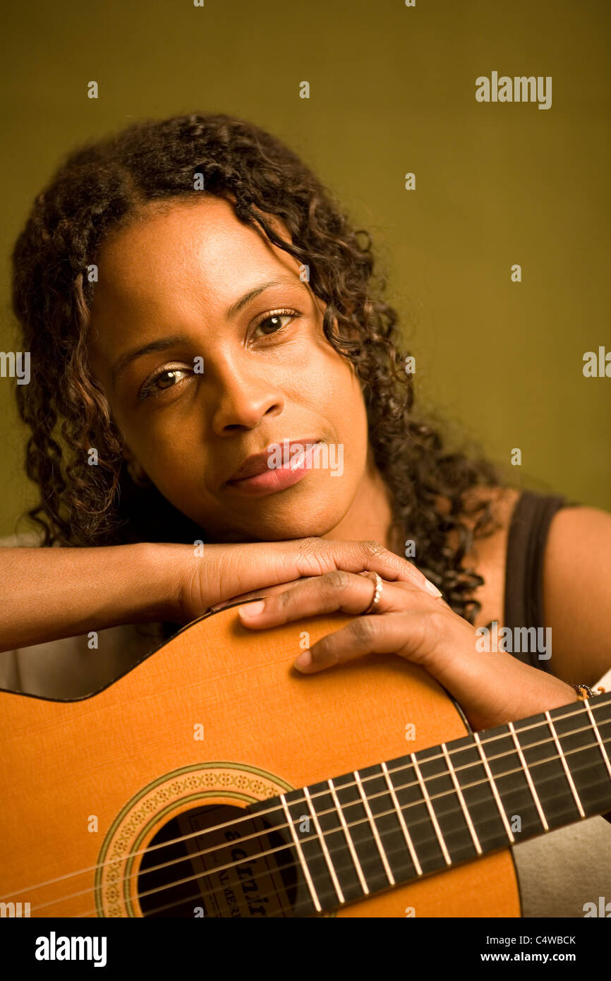 Portrait of Female with guitar - Stock Image