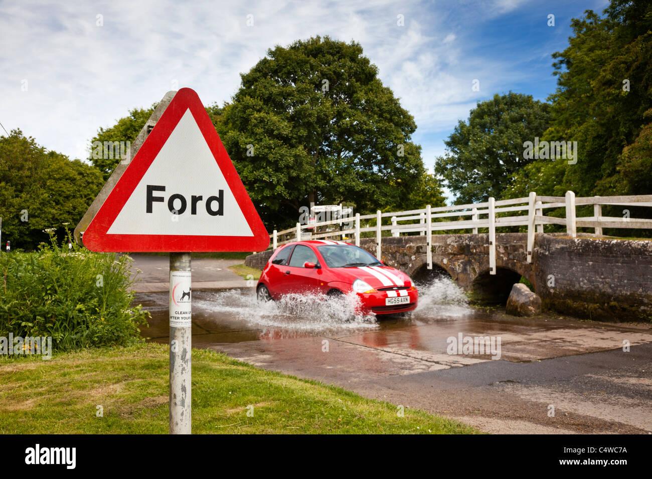 Vehicle car fording a river at Tarrant Monkton, Dorset, England, UK - Stock Image