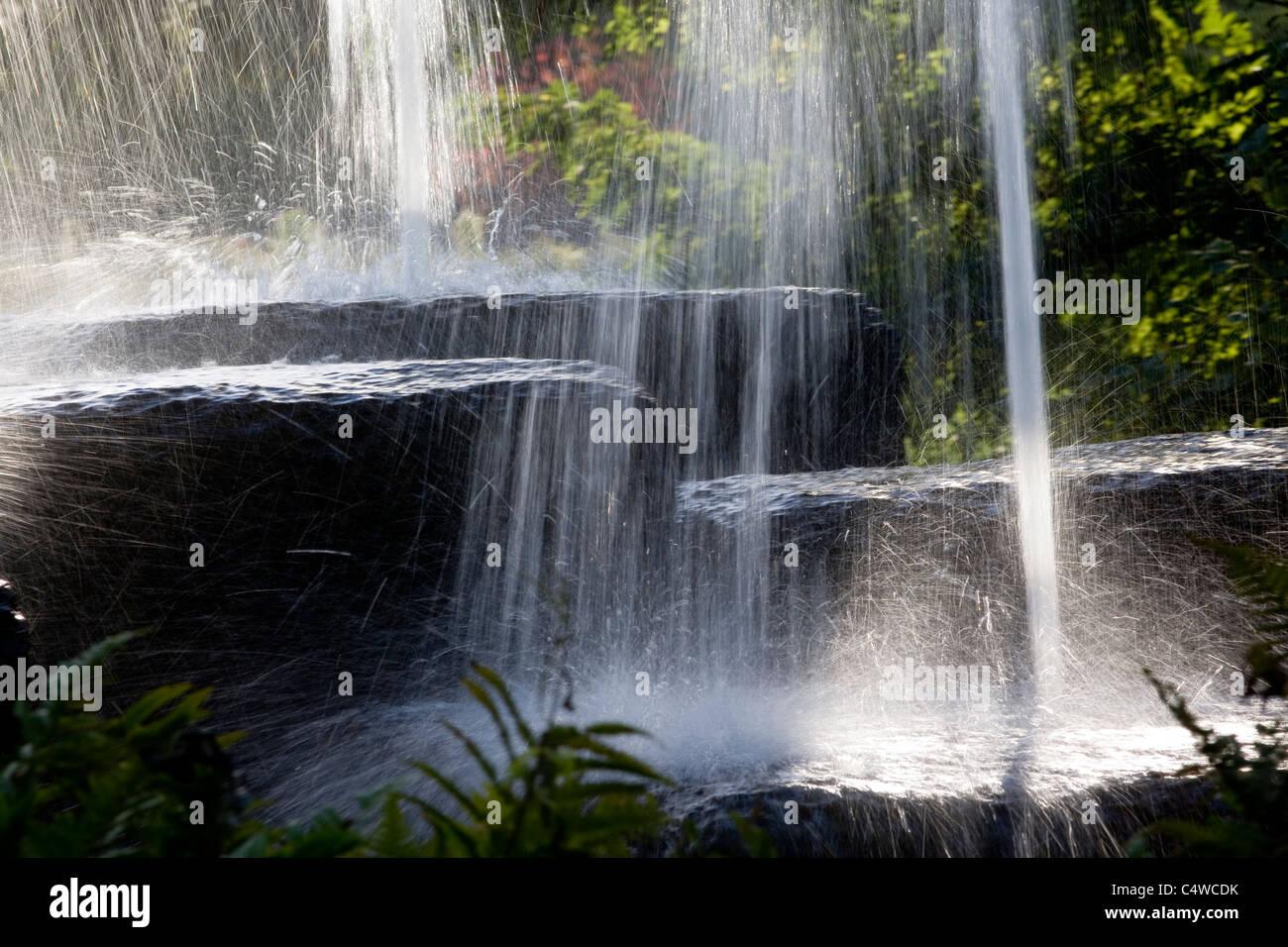 Water splashing from rocks - Stock Image