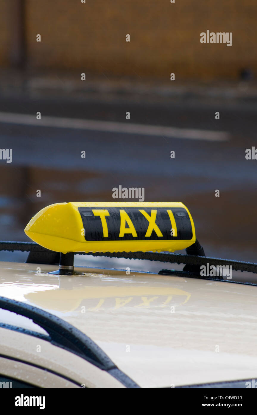 Taxi sign in the rain, ready for hire. Berlin,Germany - Stock Image