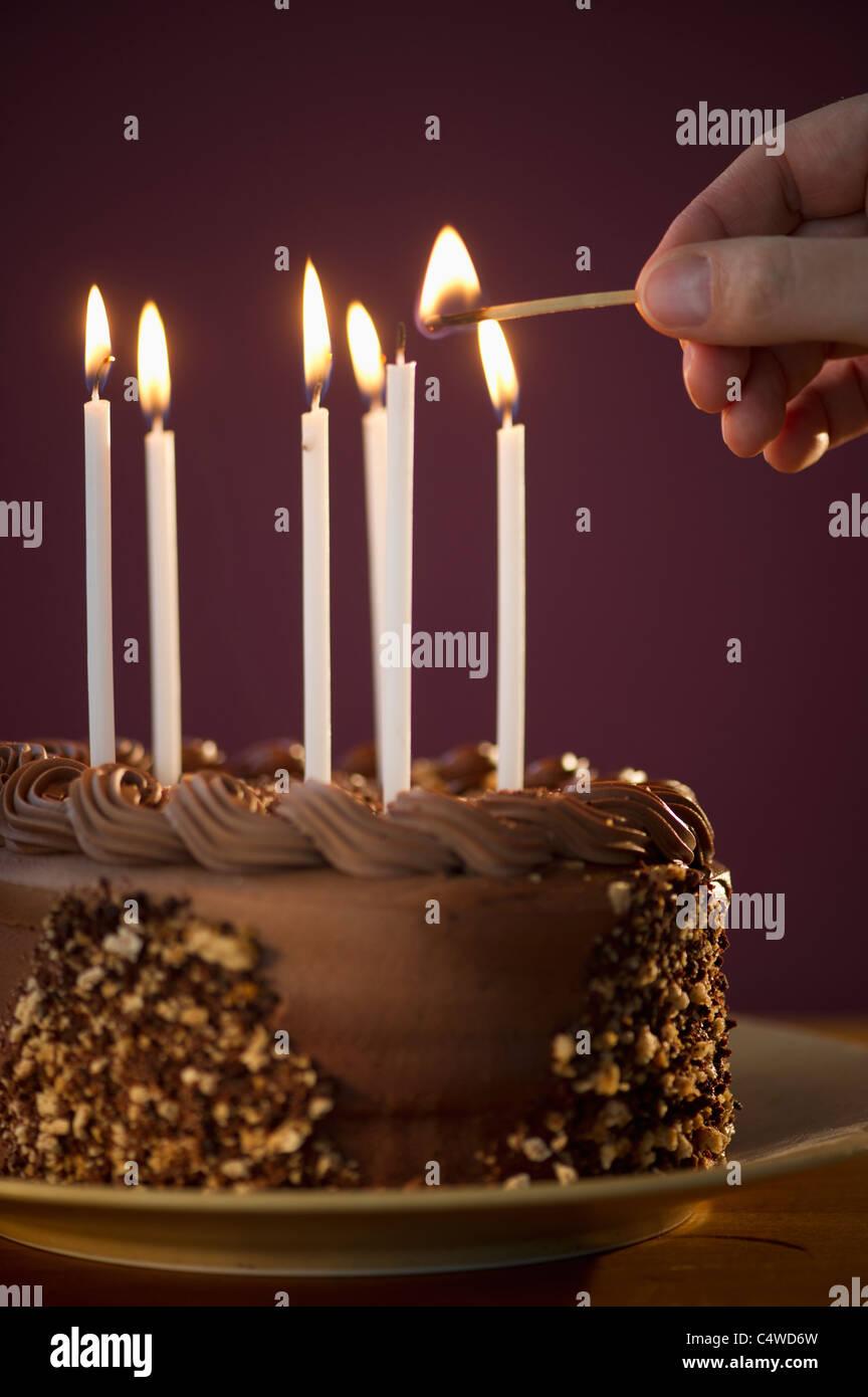 Tremendous Studio Shot Of Man Igniting Candles On Chocolate Birthday Cake Birthday Cards Printable Trancafe Filternl