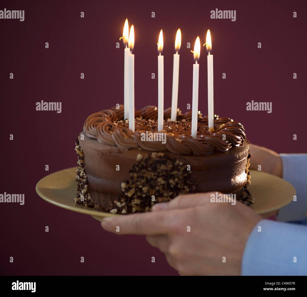 Amazing Studio Shot Of Man Holding Chocolate Birthday Cake Stock Photo Birthday Cards Printable Trancafe Filternl