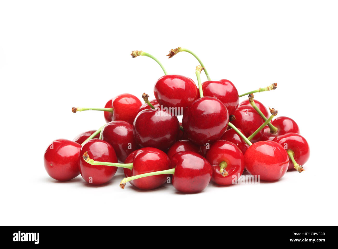 Pile of red cherries isolated on the white background - Stock Image