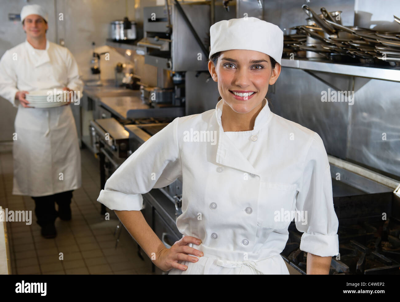 USA,New York,New York City,Chef and cook in commercial kitchen Stock Photo