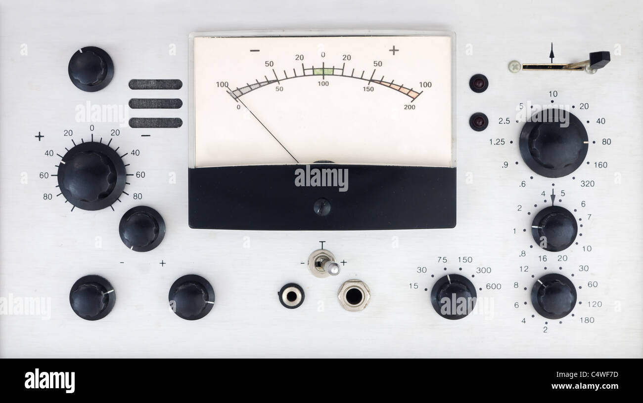 vintage electronic control panel with knobs, switches and meter - Stock Image