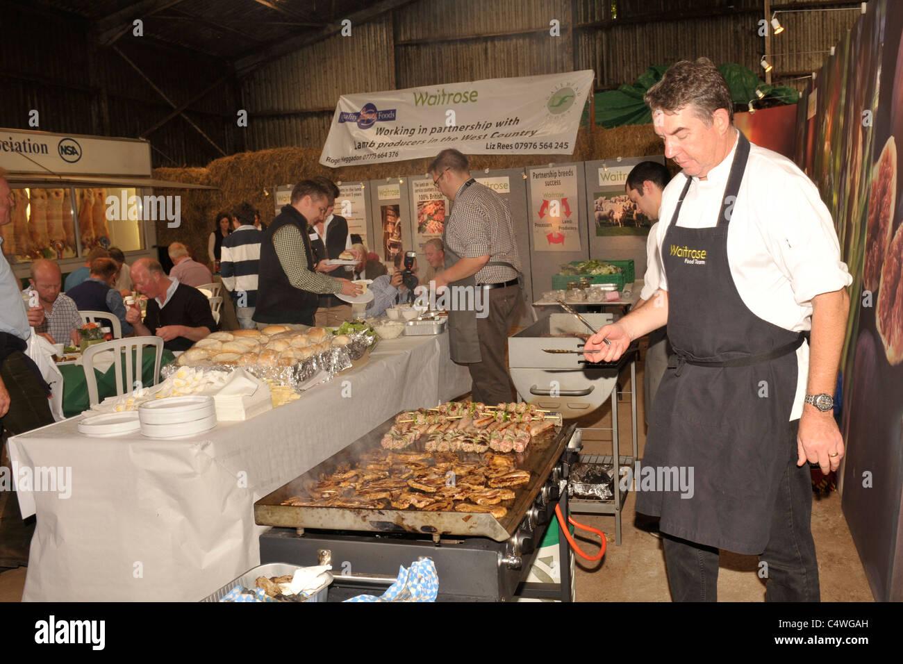 waitrose chefs on BBQ - Stock Image