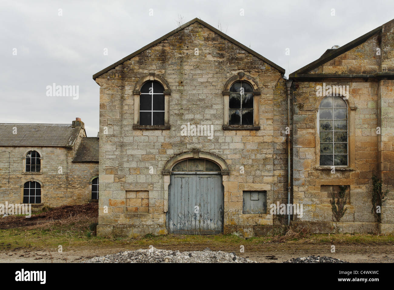 An old barn/saw mill with Facial Characters (eyes, mouth, cheeks), North Yorkshire - Stock Image