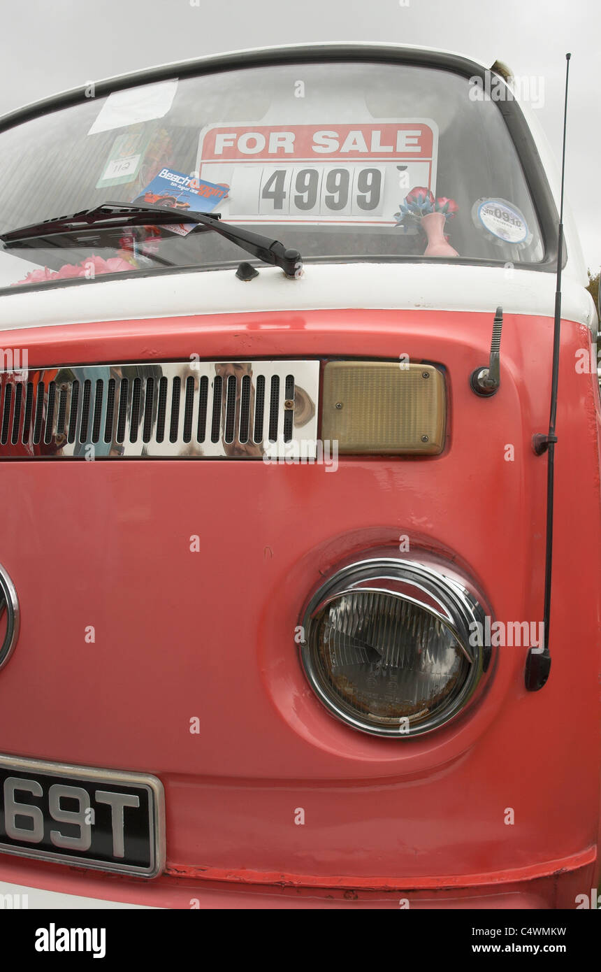 An old and slightly rusty VW Campervan for Sale - Stock Image