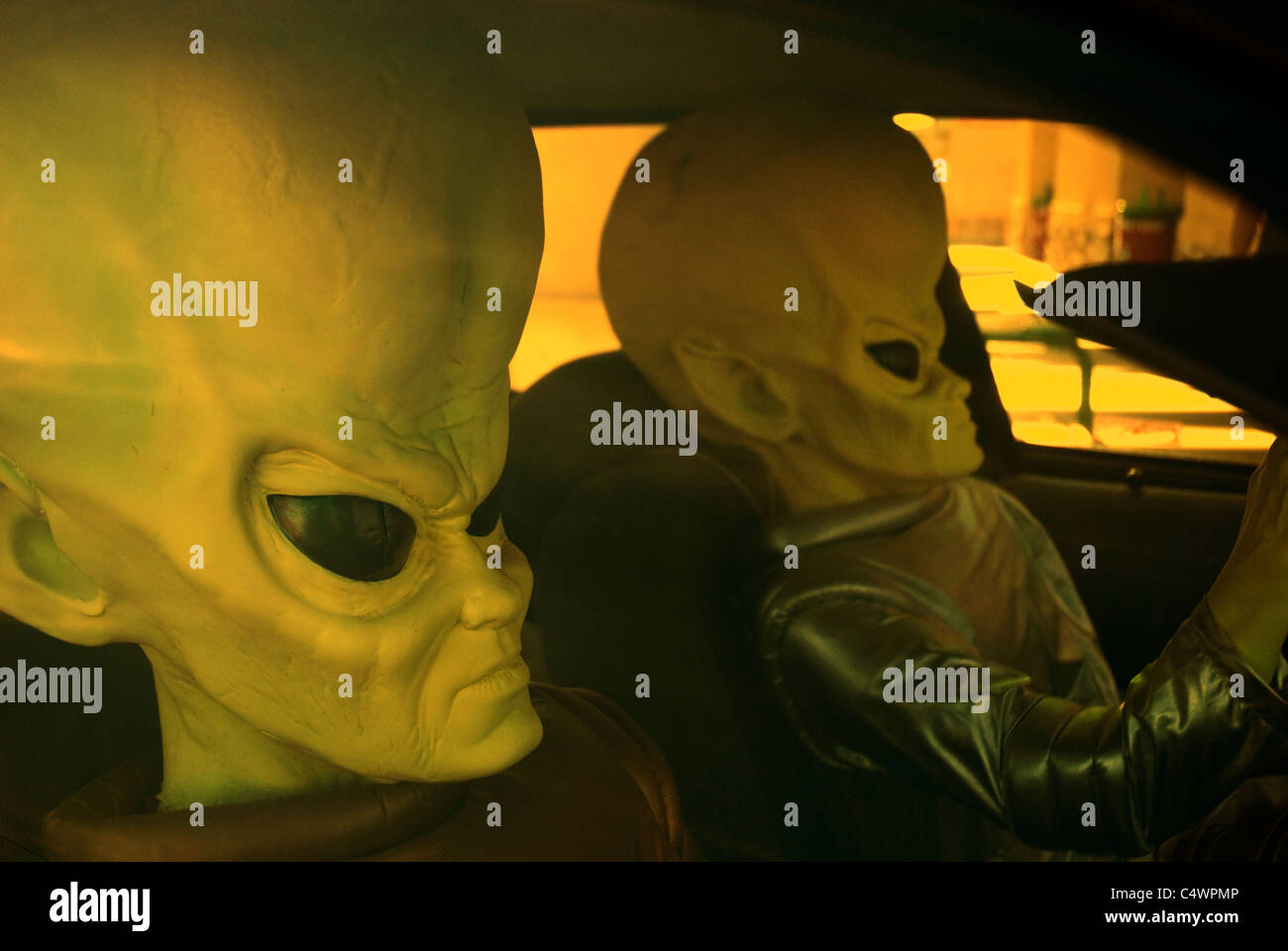 Driving aliens - Stock Image