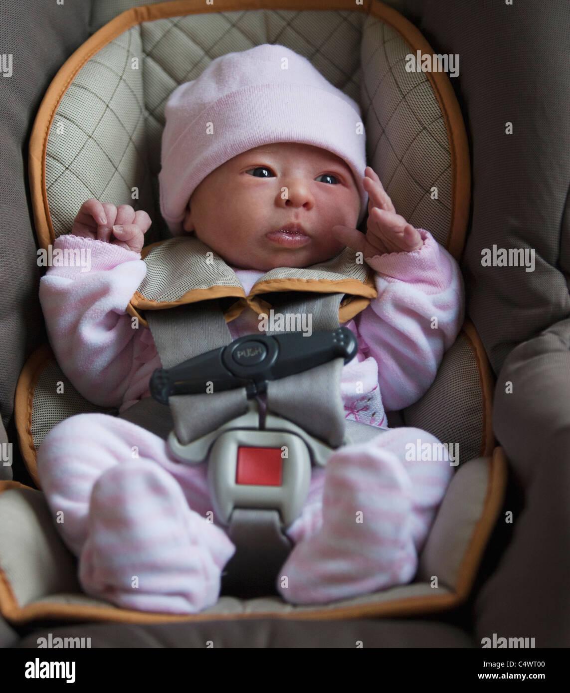 USA, Utah, Salt Lake City, Portrait of newborn girl (0-1months) in ...
