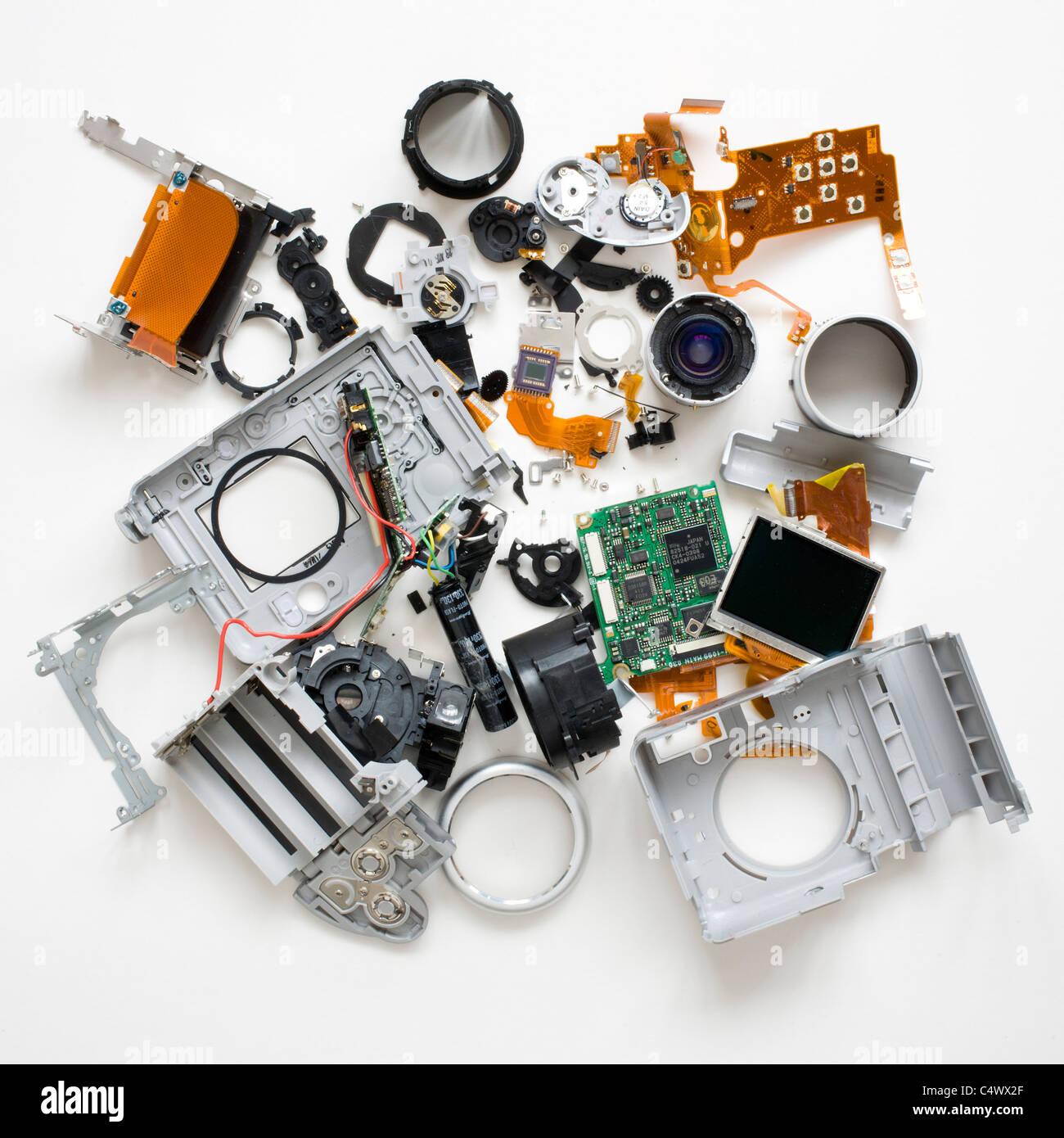 Disassembled broken compact camera - Stock Image
