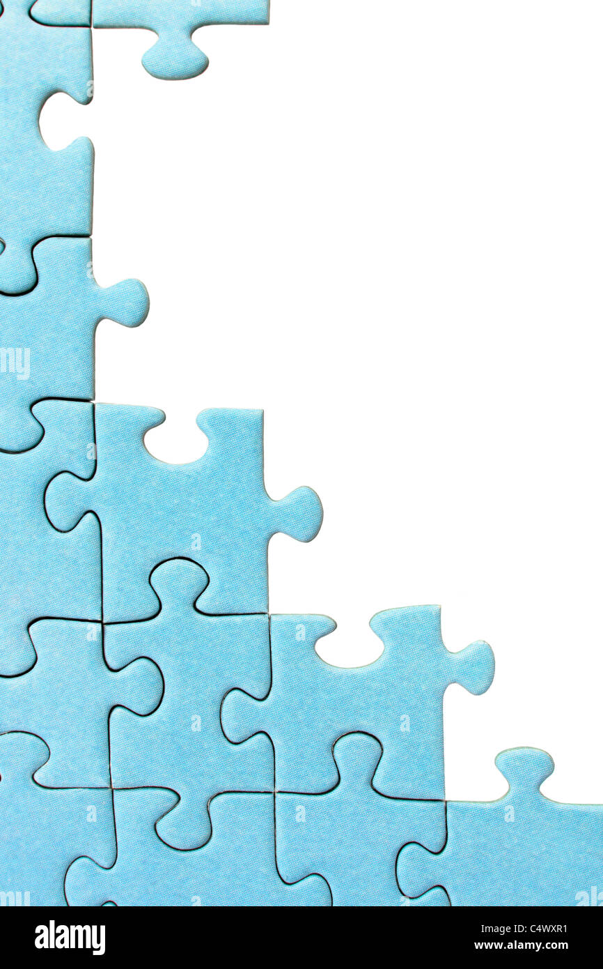 Plain blue jigsaw frame with a white background. - Stock Image
