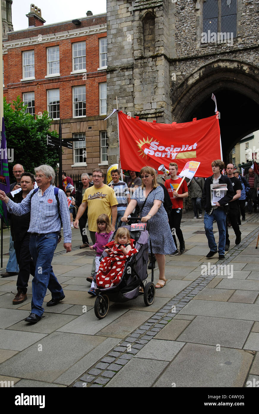 Trade Unionists & Socialist Party members protesting against public service cuts enter the historic city of Winchester Stock Photo