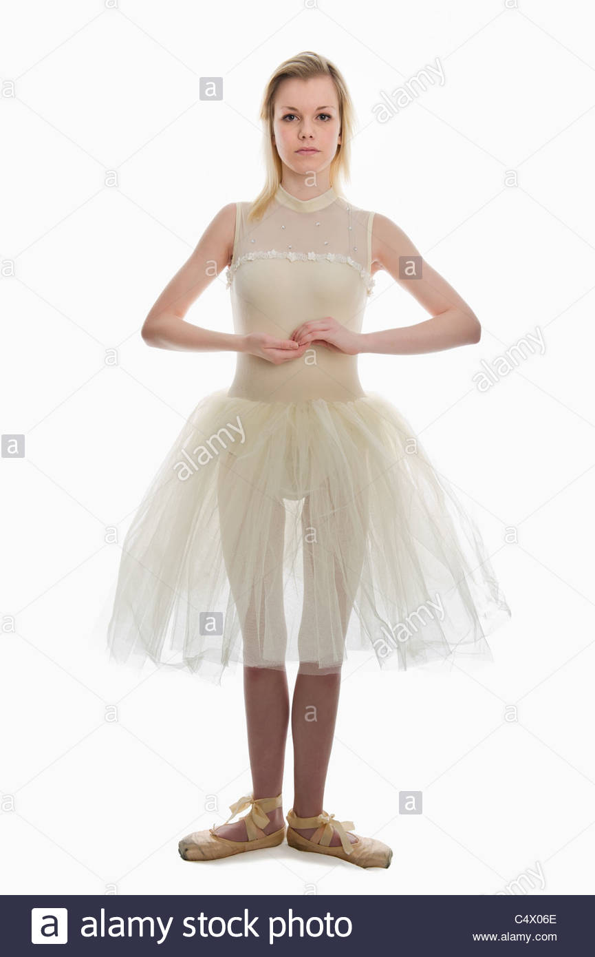 e4ef08f4f teen girl ballet dancer standing in a tutu in points on a white ...