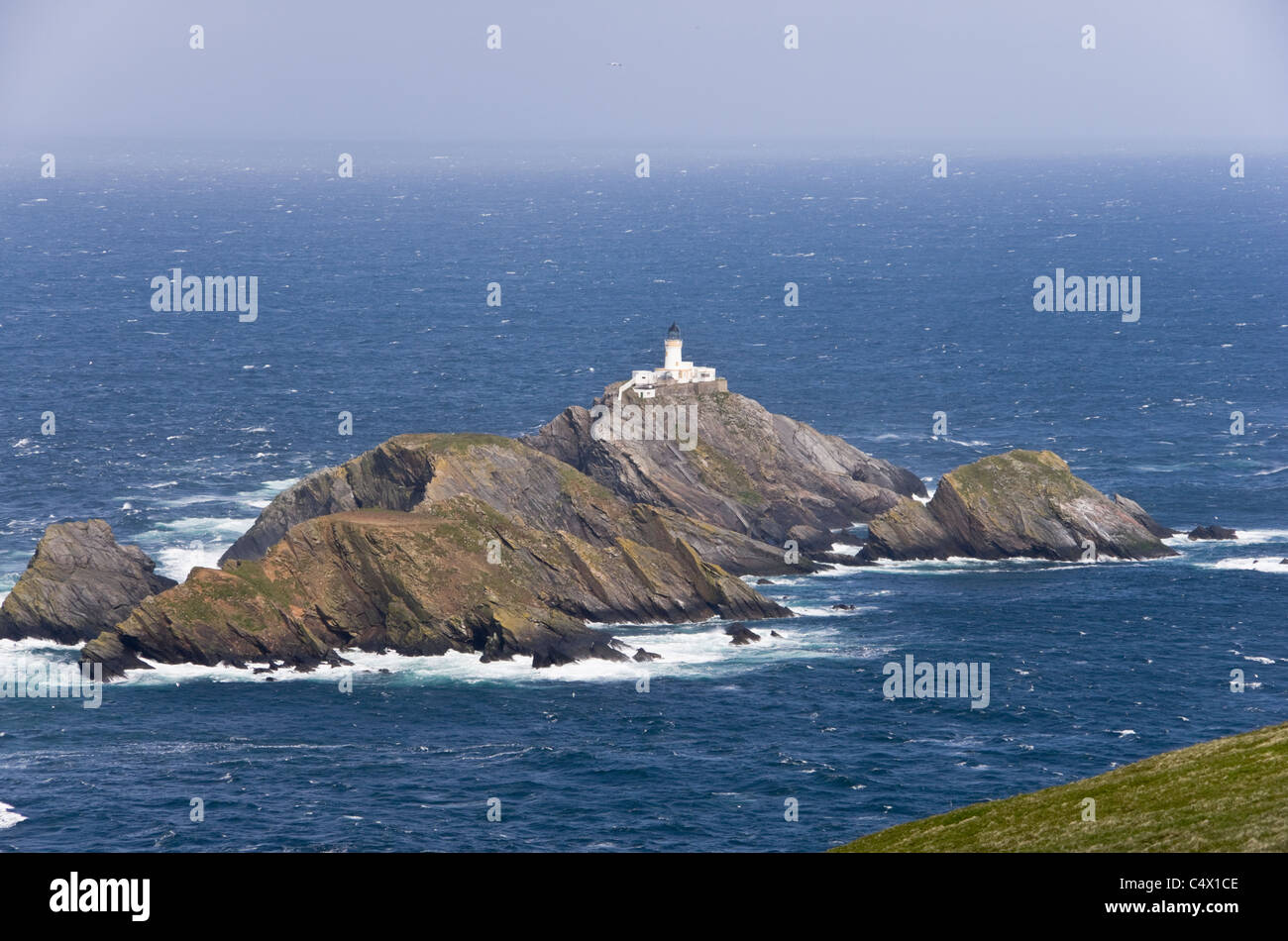 Unst, Shetland Islands, Scotland, UK. View to Muckle Flugga rocky islands and most northerly lighthouse in Britain - Stock Image