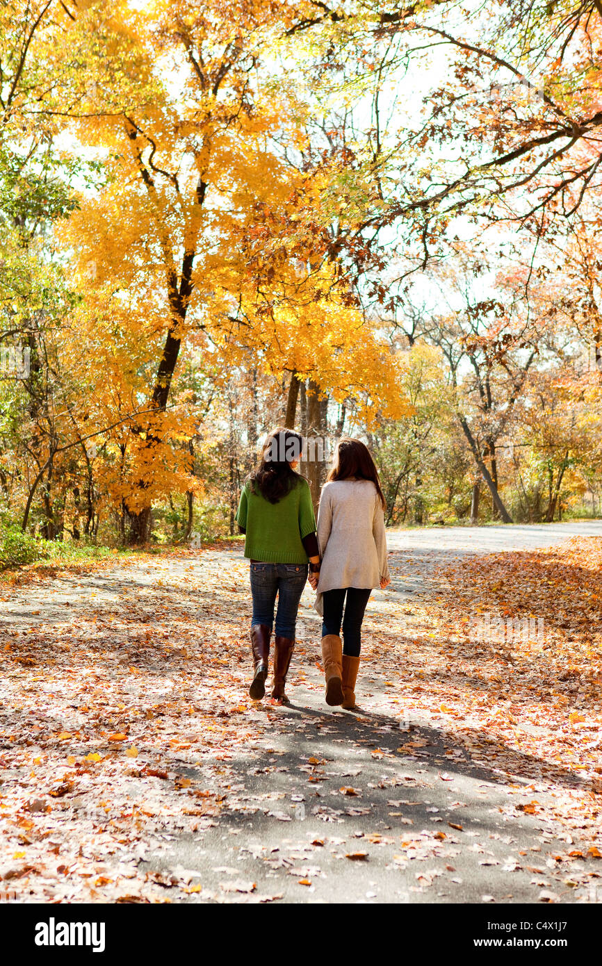 mother and daughter taking a stroll - Stock Image