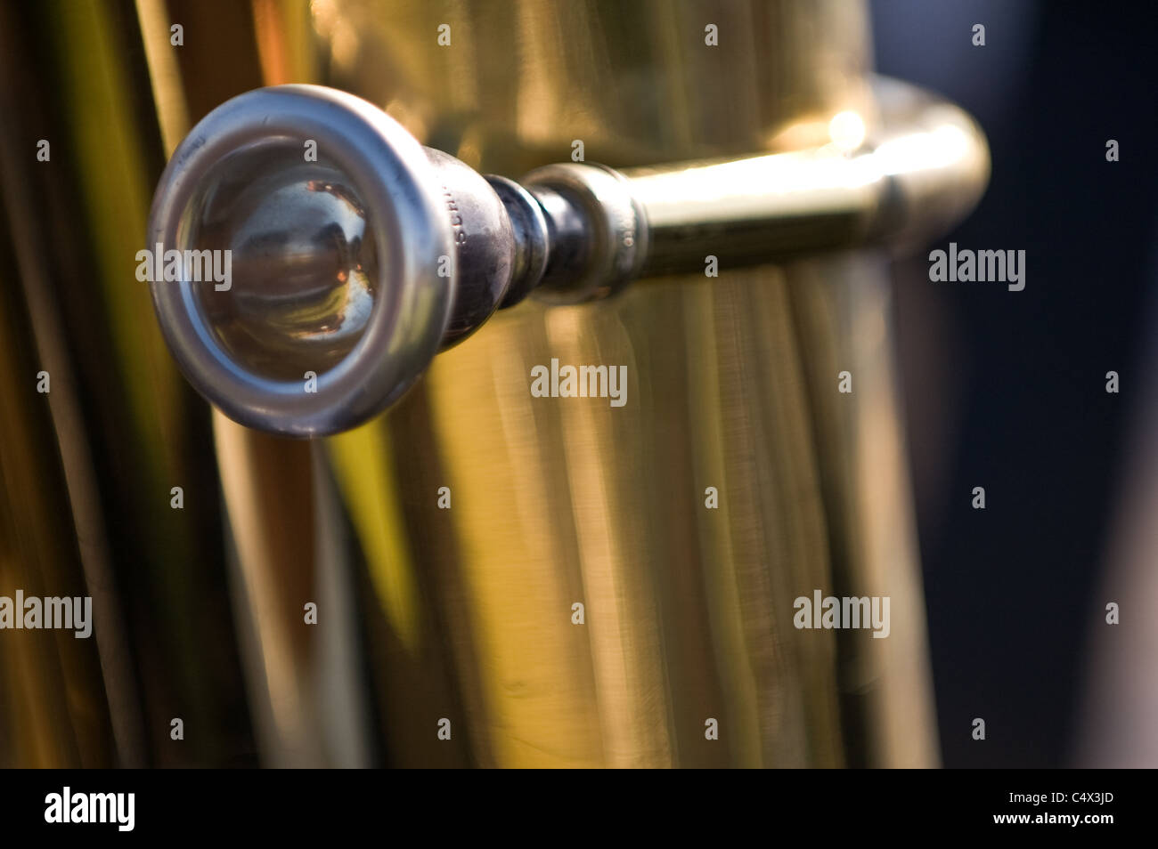 At the Fullerton graduation ceremony a close up picture of a tuba mouthpiece. - Stock Image
