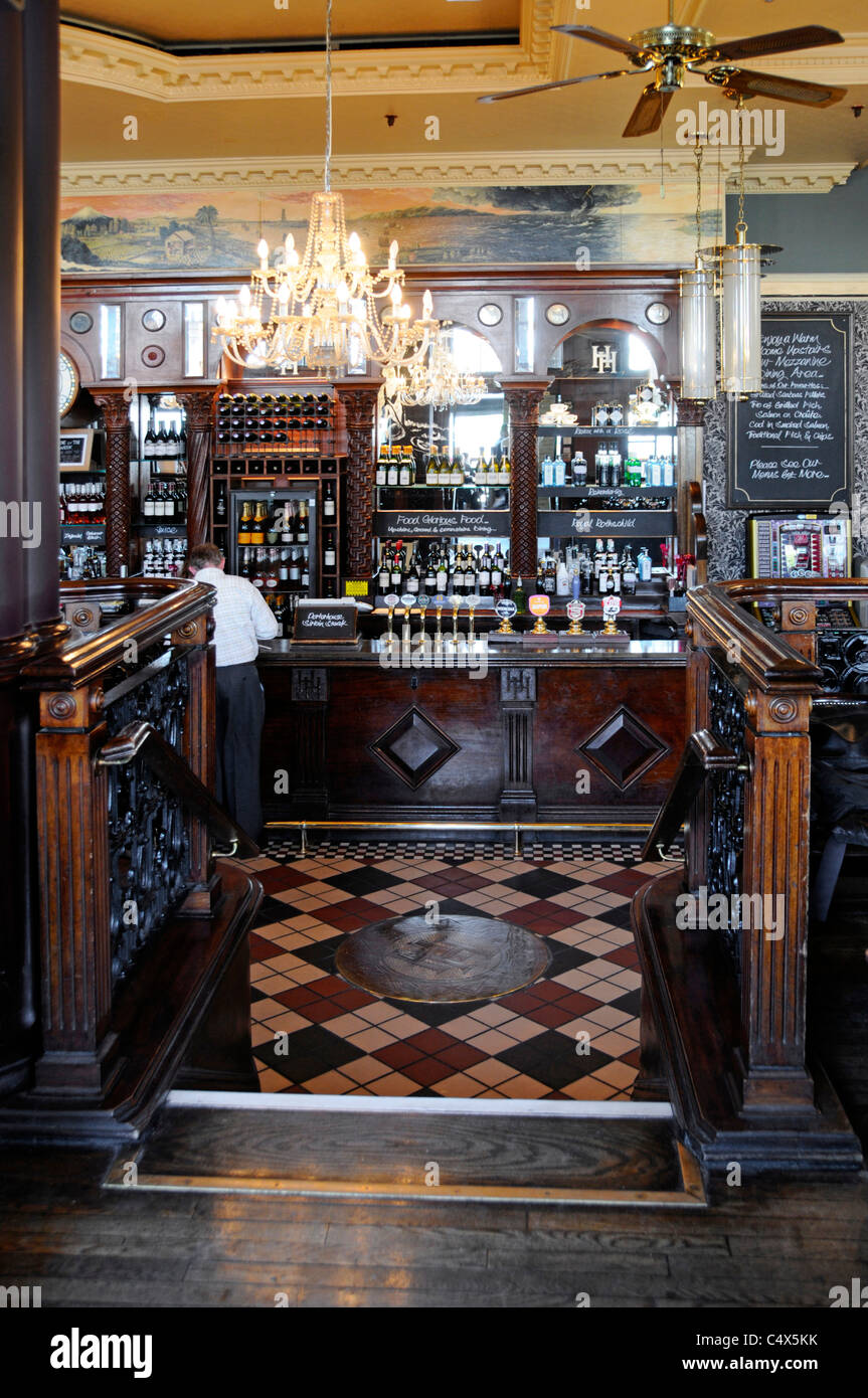 Interior of London pub bar counter at The Horniman before lunchtime rush at Hays Galleria beside River Thames - Stock Image