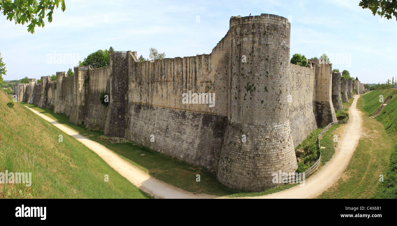 ramparts or fortifications and moat of a castle from medieval times - Stock Image