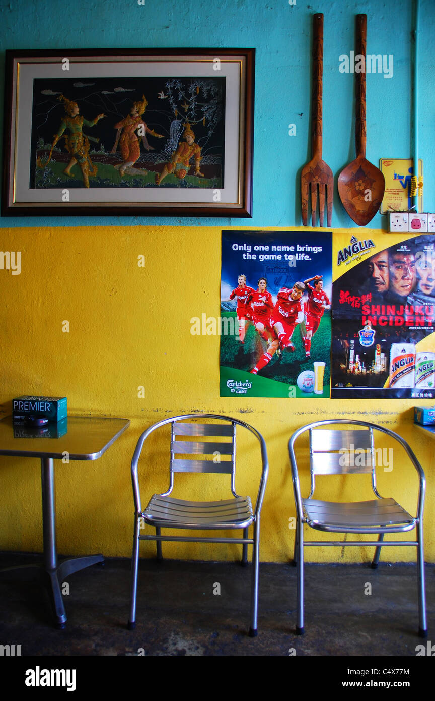 Typical Restaurant And Bar Interior In Georgetown, Penang, Malaysia.  Features Furniture And Football Posters.