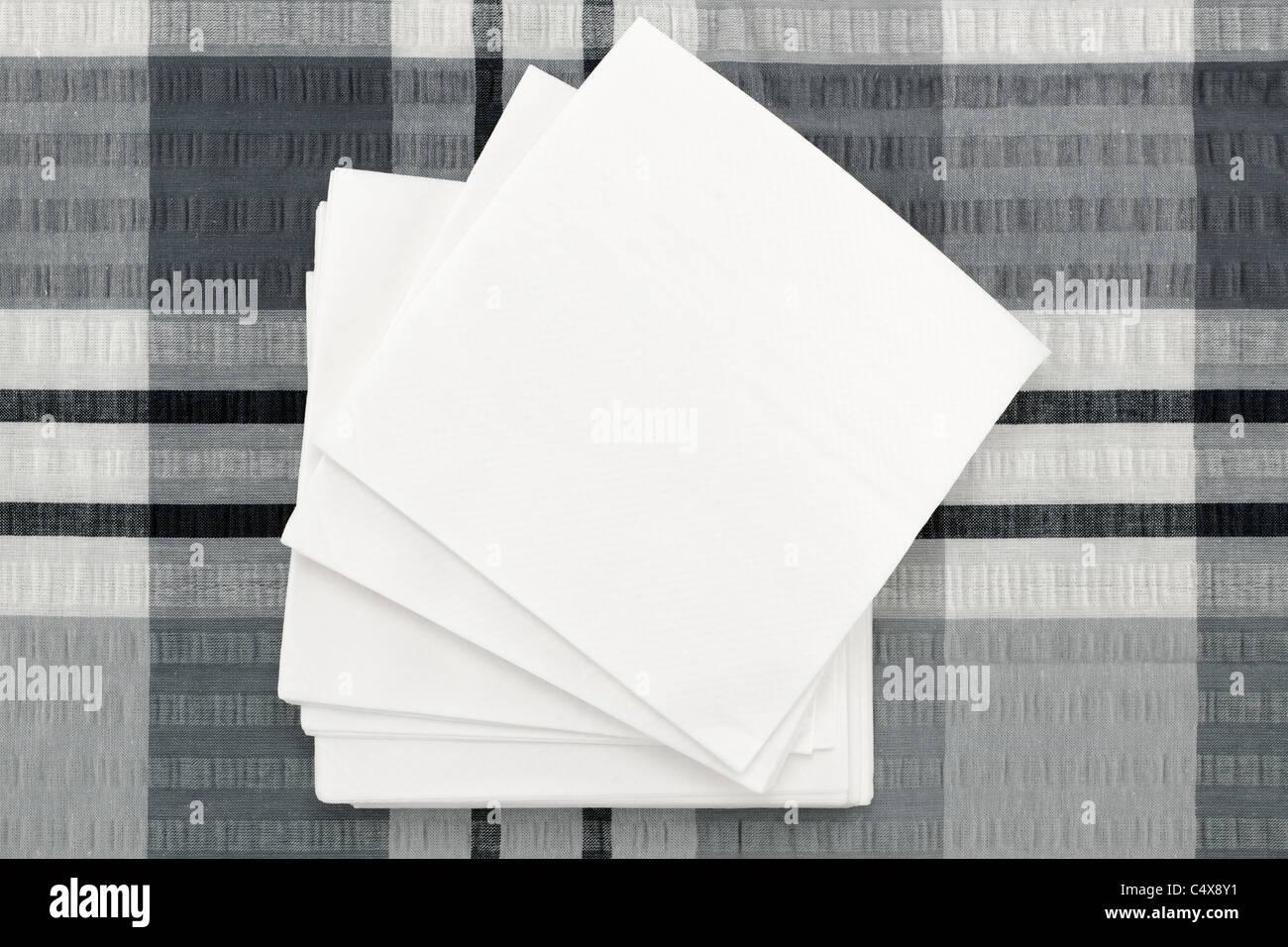 Pile of white napkins - Stock Image