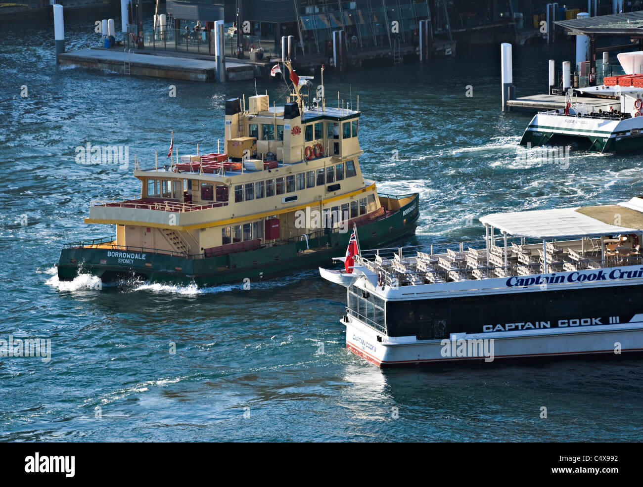 Ferry Boats Come and Go on Regular Schedules From Circular Quay Sydney Harbour to Outlying Districts NSW Australia Stock Photo