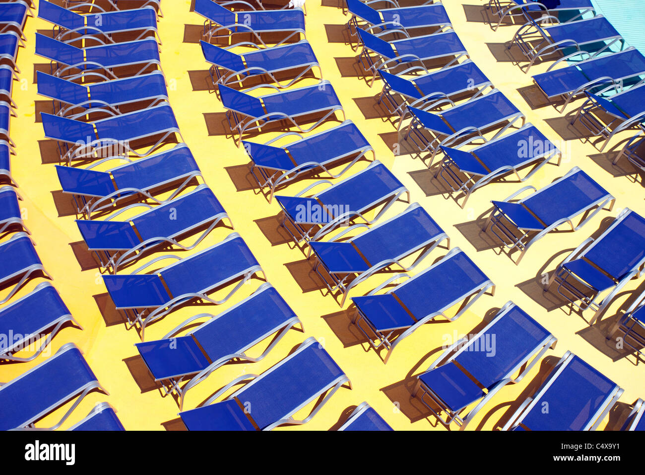 Cruise ship deck with lounge chairs, debarking from Barcelona, Spain Stock Photo