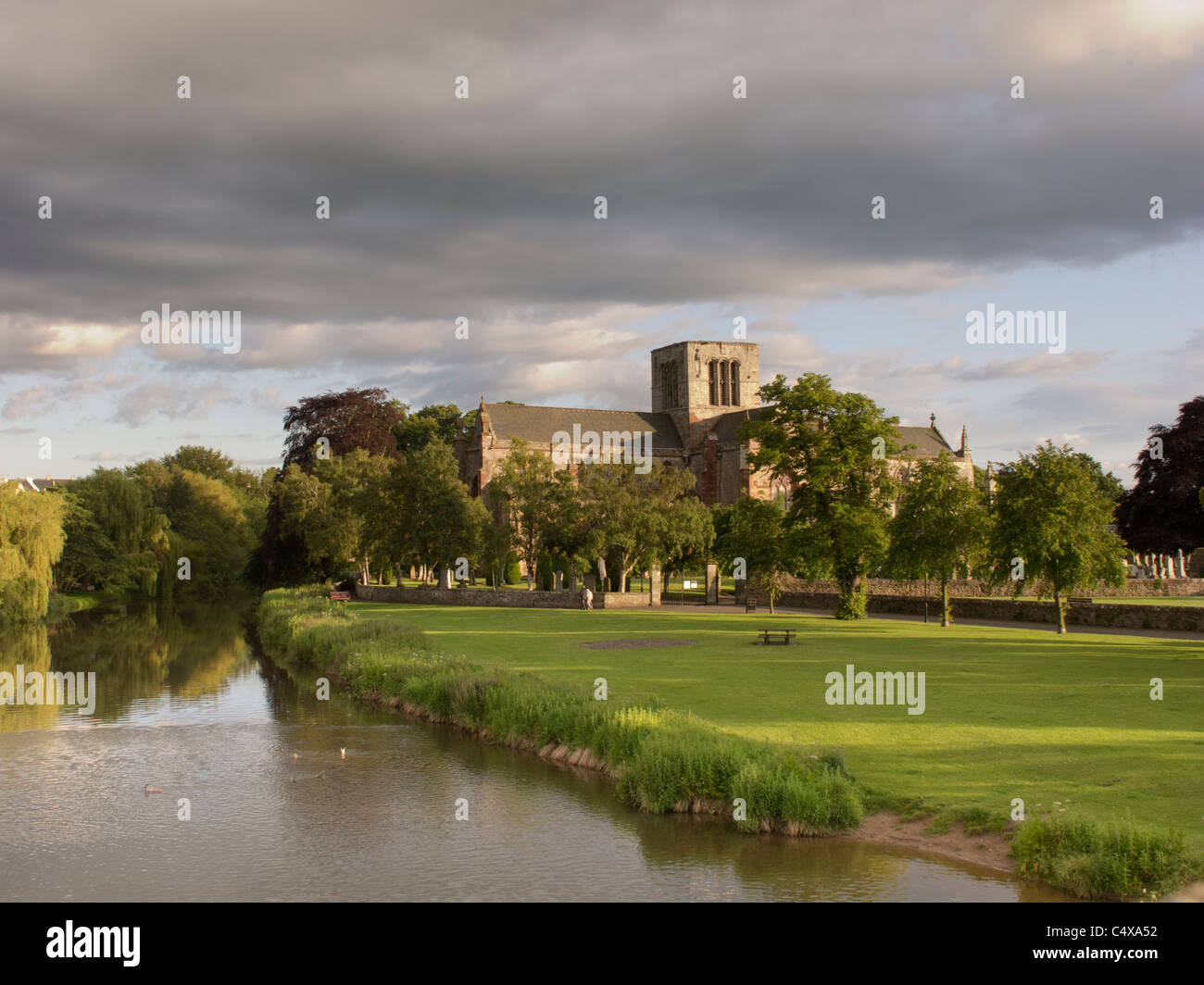 St Mary's Collegiate Church viewed across the River Tyne in the historic town of Haddington, East Lothian, Scotland - Stock Image