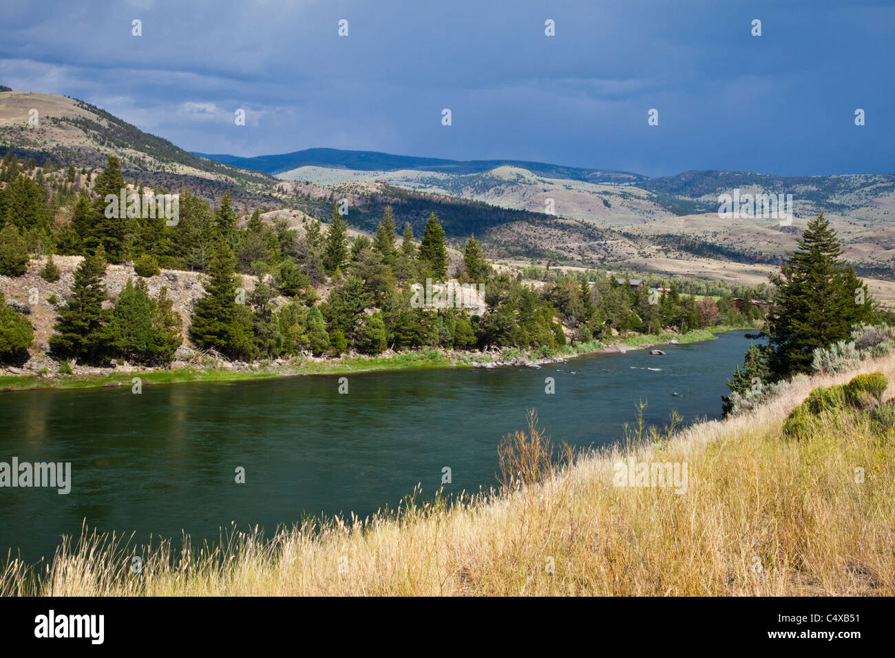 Light before storm on Yellowstone River along scenic highway US 89 - Stock Image