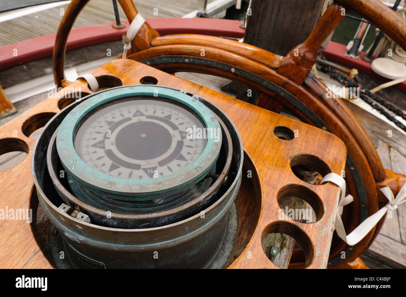 Ship's compass and wheel - Stock Image