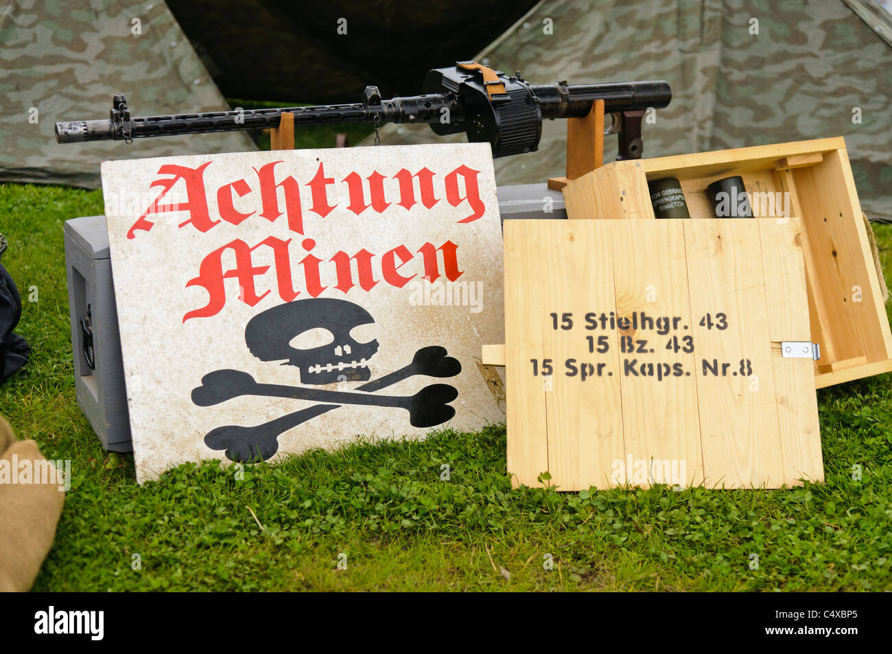 German warning sign for mines (minen) and a box of stick grenades. - Stock Image