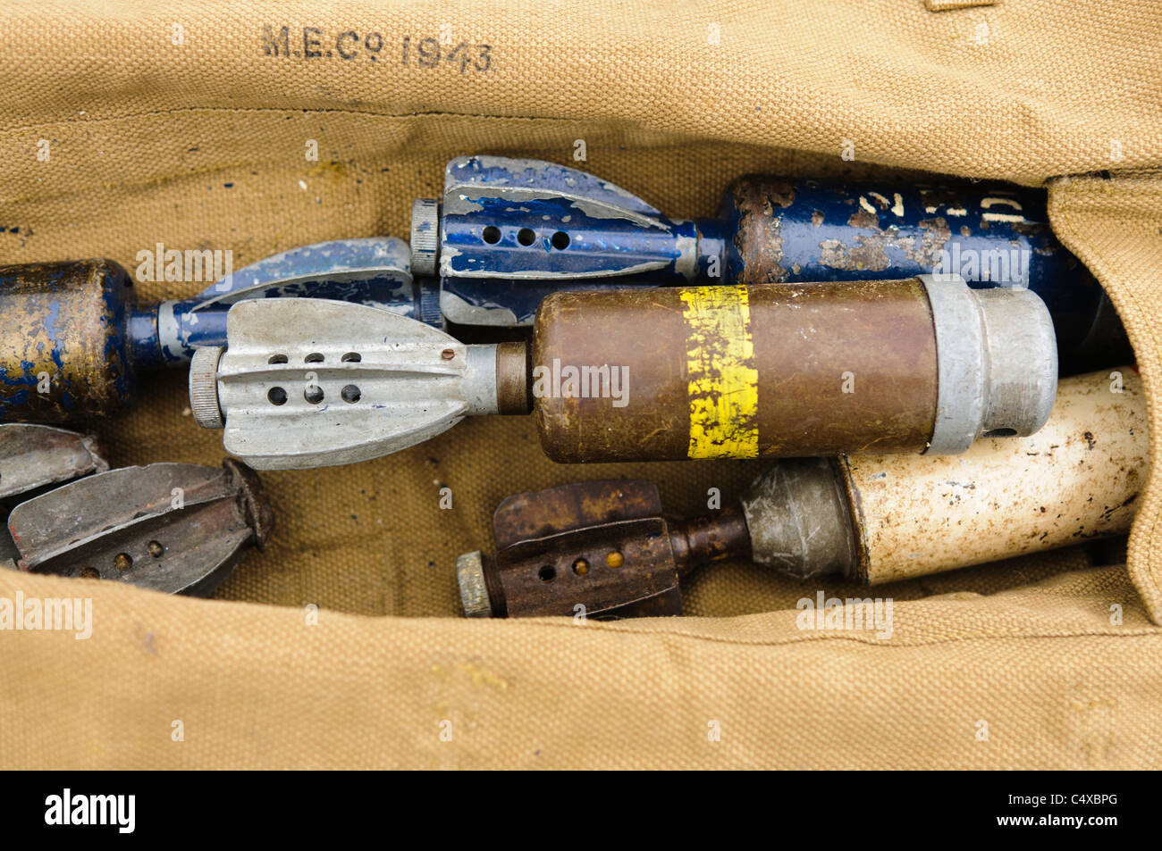 Bag with assorted WW2 bombs, grenades and mortars - Stock Image