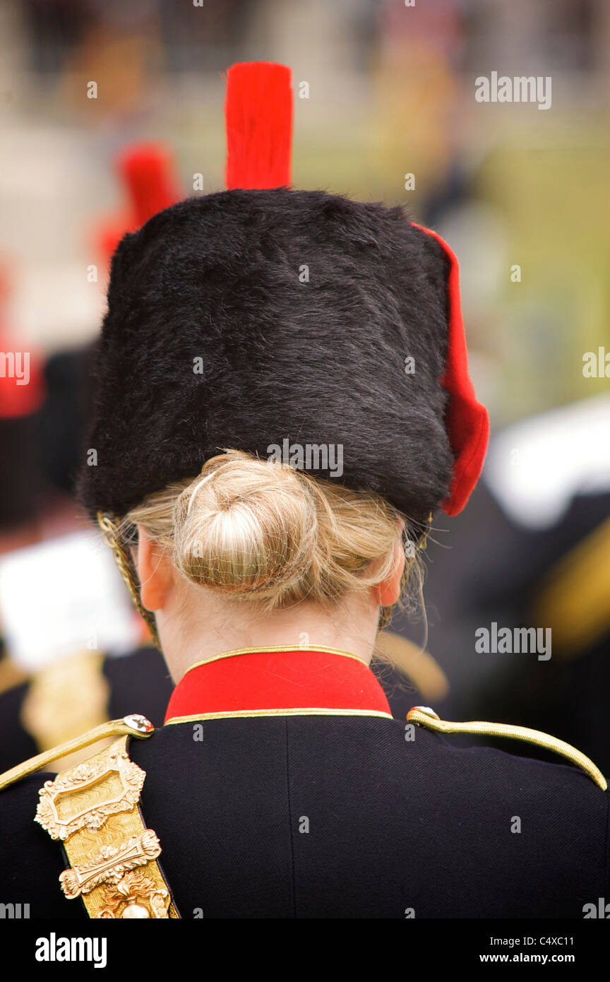 Rear view of female military band member - Stock Image
