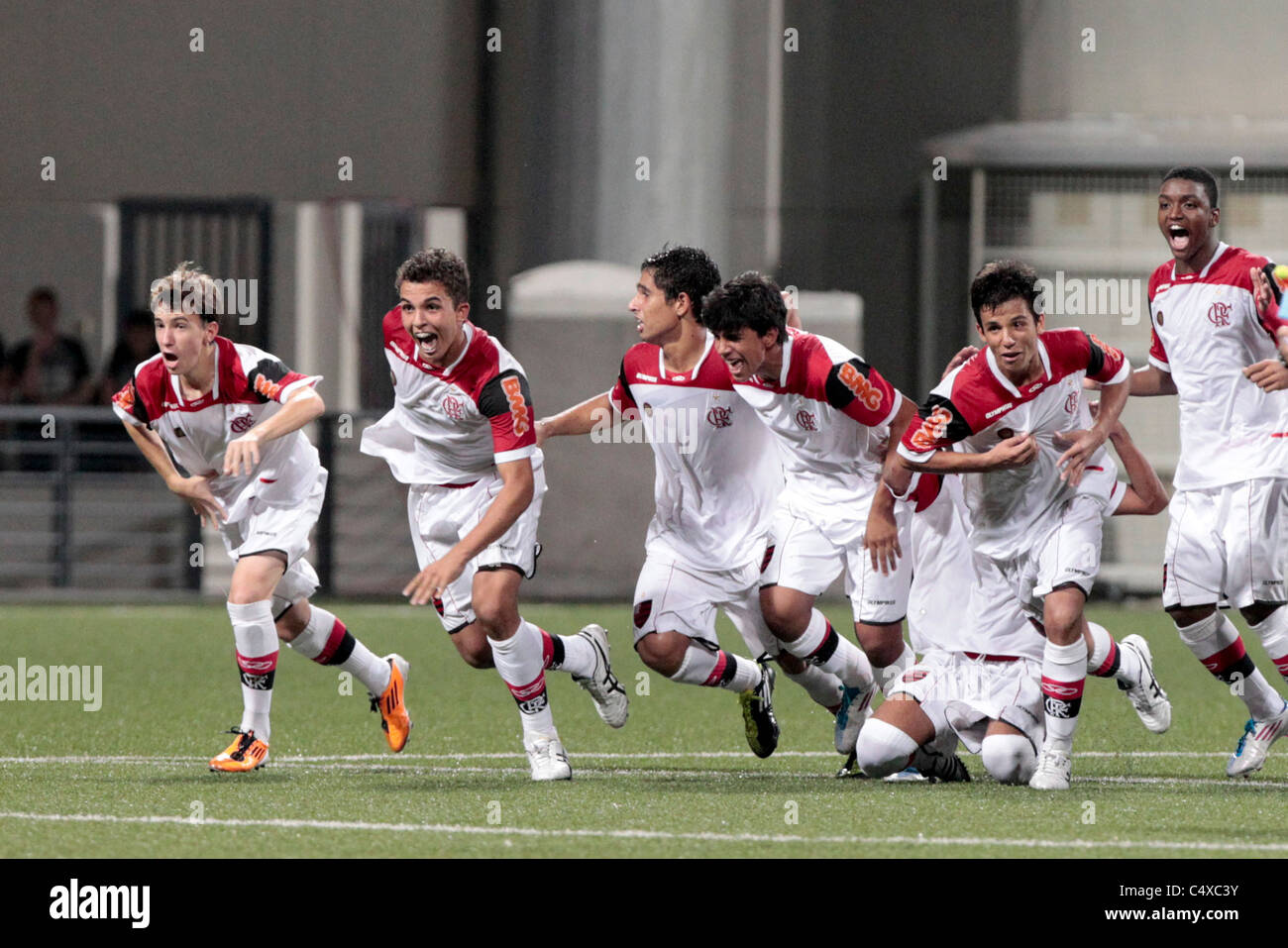 CR Flamengo players reacting to their 4-3 penalty shoot-out victory during the 23rd Canon Lion City Cup - Stock Image