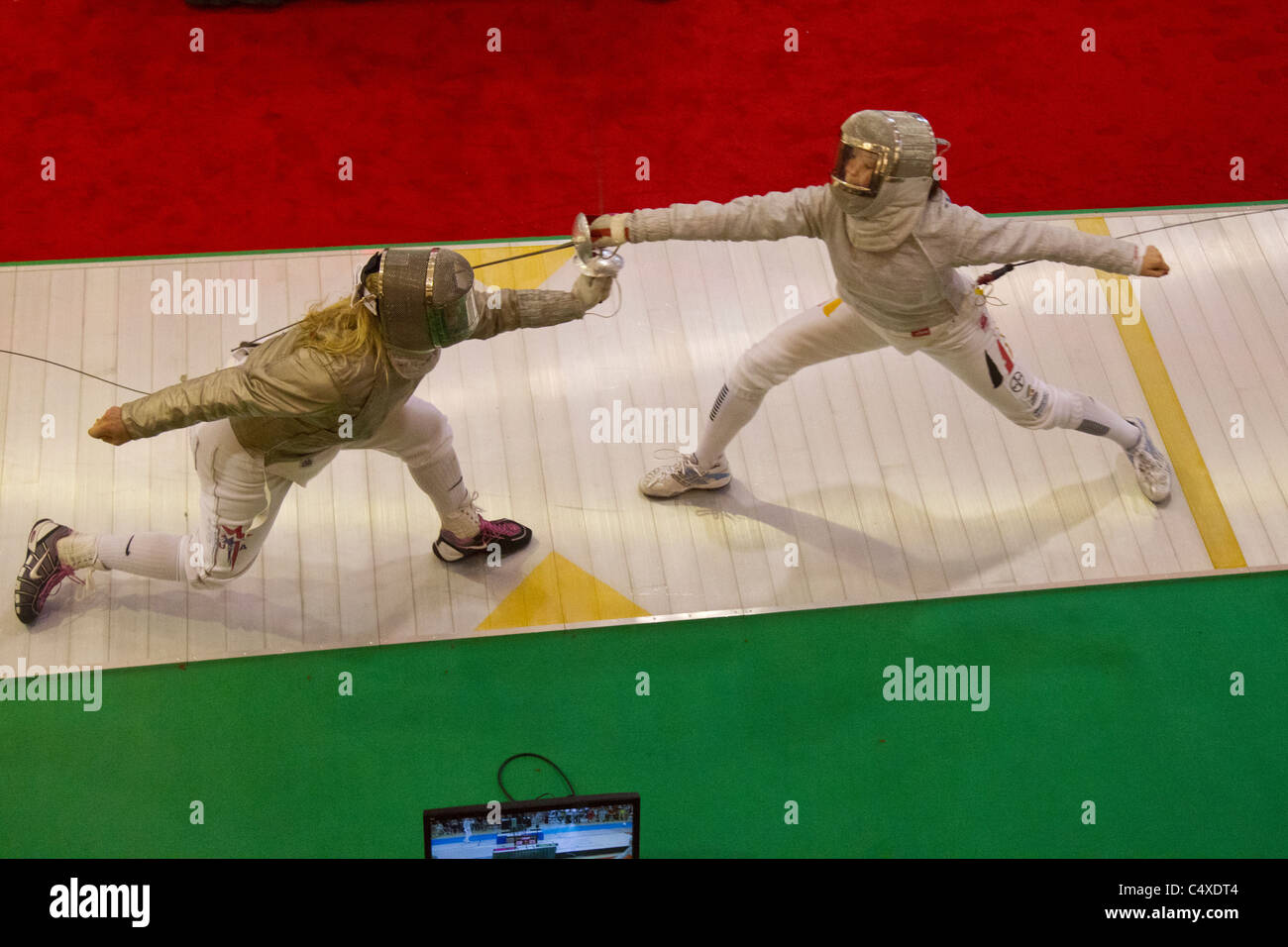 Mariel Zagunis (USA) competing against Anna Limbach (GER) the 2011 New York Saber World Cup. Stock Photo