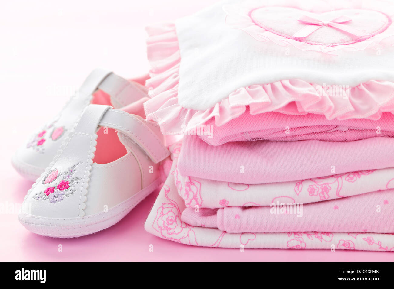 25e116cabdd98 Pink infant girl clothing and shoes for baby shower - Stock Image